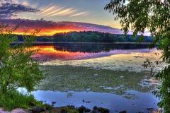 Sunrise on the lake Stock Images