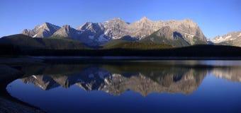 Sunrise on lake with mountains stock image