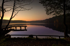 Sunrise lake. And the trees silhouette Stock Image