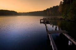 Sunrise lake. And old wooden footbridge Royalty Free Stock Images