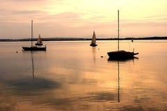 Sunrise lake. With many boats Royalty Free Stock Image