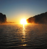 Sunrise on the lake. Early foggy morning. Sunrise on the lake. Photographed from a boat Royalty Free Stock Photo