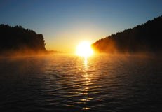 Sunrise on the lake. Early foggy morning. Sunrise on the lake. Photographed from a boat Royalty Free Stock Photos