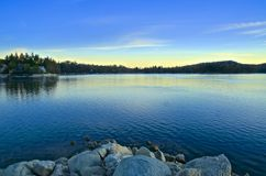 Sunrise Lake Arrowhead CA. Beautiful colorful sky and lake at sunrise on Lake Arrowhead in California Royalty Free Stock Photography
