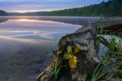 Sunrise on lake in autumn with reflection royalty free stock image
