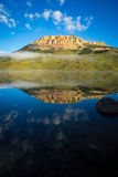 Sunrise on lake with Bear to Butte in the background, Montana. Beautiful sunrise illuminating Beartooth Butte and Lake in Montana Stock Photo