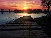 Sunrise on lake. Beautiful red sunrise on the lake Stock Photography