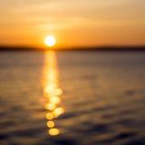 Sunrise on lake and bokeh Stock Photos