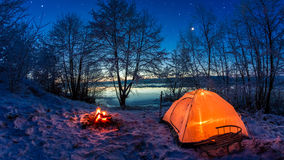 Sunrise lake covered with snow at dusk in winter Stock Photography