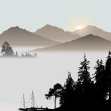 Sunrise on the lake during foggy day Royalty Free Stock Images