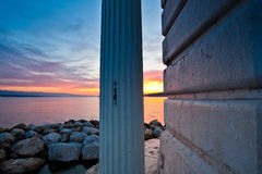 Sunrise at Lake Geneva, Switzerland. Lake Geneva lighthouse with colourful sunrise in background Royalty Free Stock Photography