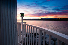 Sunrise at Lake Geneva, Switzerland. Lake Geneva lighthouse with colourful sunrise in background Stock Photo