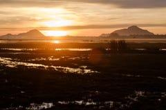 Sunrise on lake with hills in Sri Lanka. Sunrise scene on lake with hills in Sri Lanka stock photos