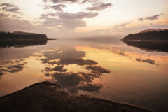 Sunrise on lake Liptovska Mara, Slovakia. Mirror reflection on water Royalty Free Stock Photos