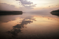 Sunrise on lake Liptovska Mara, Slovakia. Mirror reflection on water Stock Images
