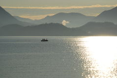 Sunrise on Lake Maggiore. Fishermen at Sunrise. LAke Maggiore, Italy stock image