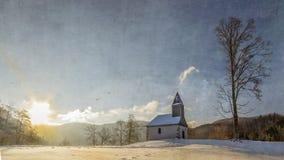 Sunrise on lake. Xonrupt longemer in winter chapel st florent Stock Image