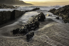 A sunrise landscape image of Storm`s River, which is a popular tourist attraction of the garden route in South Africa.  Royalty Free Stock Photography