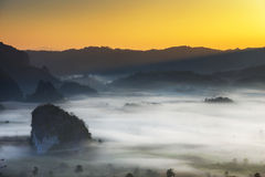 Sunrise landscape and the mist covering field at Phu Lang Ka,Thailand. Stock Photos