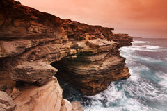 Sunrise landscape of ocean with waves clouds and rocks Royalty Free Stock Photos