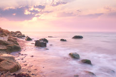Sunrise landscape over beautiful rocky coastline in the Sea. With sunbeams royalty free stock photos