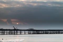 Sunrise landscape of pier under construction and development Royalty Free Stock Image