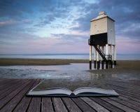 Sunrise landscape of wooden stilt lighthouse on beach in Summer Royalty Free Stock Image