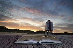 Sunrise landscape of wooden stilt lighthouse on beach in Summer Stock Photos