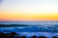 Sunrise on Las Rotas beach in Denia royalty free stock photo