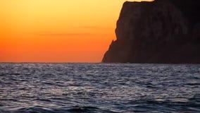 Sunrise on `Las Rotas` beach in Denia stock footage