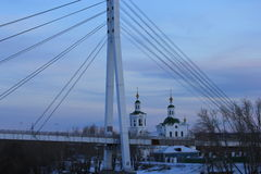 Sunrise. The left bank of the Tura river and the Lover`s bridge. Tyumen. Russian Siberia. The Tura Embankment is very popular place for tourists in Tyumen City royalty free stock photo