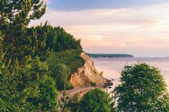 Sunrise light on cliff with pine wood. Sunrise light on the cliff with pine wood stock photography