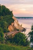 Sunrise light on cliff with pine wood. Sunrise light on the cliff with pine wood stock images