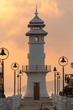 Sunrise with light house and Pier on Ko Chang Island, Thailand Stock Photo