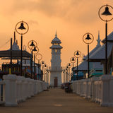 Sunrise with light house and Pier on Ko Chang Island, Thailand Royalty Free Stock Photography
