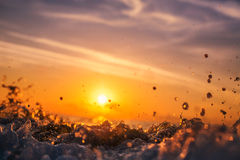 Sunrise light shining on ocean wave Royalty Free Stock Images
