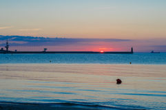 Sunrise with lighthouse on Baltic sea in Gdynia Royalty Free Stock Photo