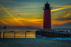 Sunrise of lighthouse with colorful sky. Colorful sunrise lighthouse on Lake Michigan in Milwaukee, Wisconsin Royalty Free Stock Images