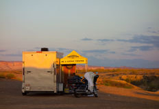 The sunrise lighting up a campsite in the desert Royalty Free Stock Photography