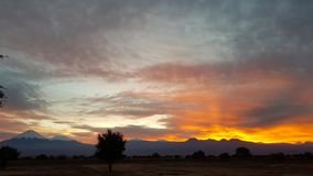 Wonderful sunrise on the volcanoes of the Andean cordillera, Atacama Desert, Chile. Sunrise lights in the arid and desolate landscape of the Atacama Desert and royalty free stock photos