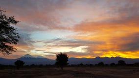 Wonderful sunrise on the volcanoes of the Andean cordillera, Atacama Desert, Chile. Sunrise lights in the arid and desolate landscape of the Atacama Desert and stock images