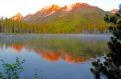 Sunrise lights the mountain tops in Yellowstone National Park. Stock Image