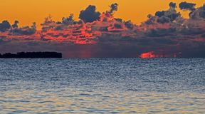 Sunrise Lights Up Cumulus Clouds Over Lake Ontario. Shoreline rocks, Lake Ontario and cumulus clouds seen from Etobicoke Point at Humber Bay Park West in Toronto stock photos
