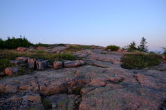 Sunrise lights up the Pink Granite rocks Royalty Free Stock Photo
