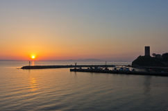 Sunrise at a little fishing harbour in Chalkidiki. Greece royalty free stock photography