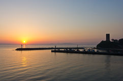 Sunrise at a little fishing harbour. In Greece royalty free stock photo