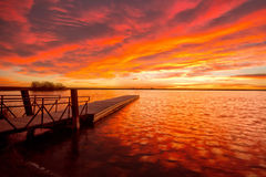 Sunrise on Lon Hagler Lake in Loveland Colorado. An intense sunrise on Lon Hagler reservoir in Loveland Colorado. The fishing dock was a great place to witness stock images