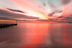 Sunrise long exposure Aberdeen beach, Scotland. Sunrise reflection in Aberdeen beach royalty free stock photos