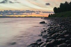 Sunrise long exposure of stony seacoast, Tallinn Stock Image