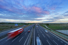 Sunrise at M1 Motorway with cars in motion royalty free stock photo